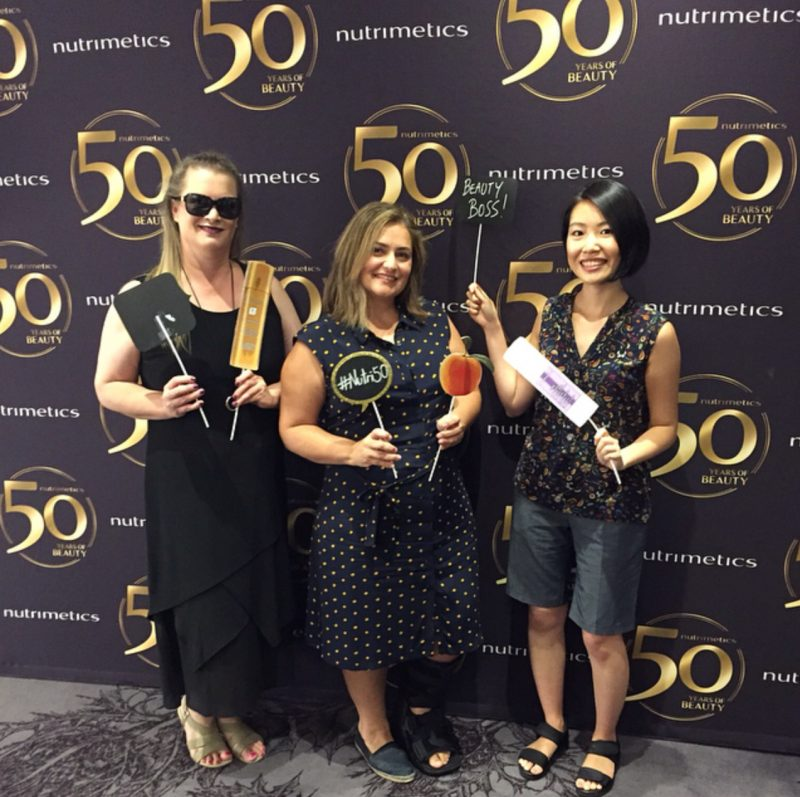 Having Fun At The Nutrimetics 50th Anniversary Photo Wall  with Bernadette from Beauty Reign and Lily from Lily Not Louise